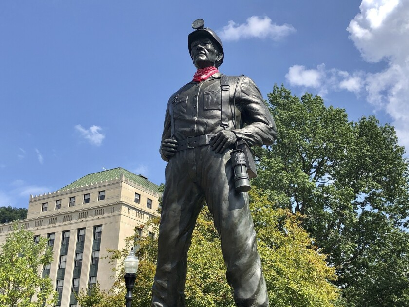 A statue of a coal miner is shown Thursday, Aug. 26, 2021, at the West Virginia Capitol in Charleston, W.Va. This weekend, marchers are retracing the steps of thousands of coal miners who participated in the Battle of Blair Mountain in southern West Virginia. At least 16 men died in the largest U.S. armed uprising since the Civil Warbefore the miners surrendered to federal troops in early September 1921. (AP Photo/John Raby)