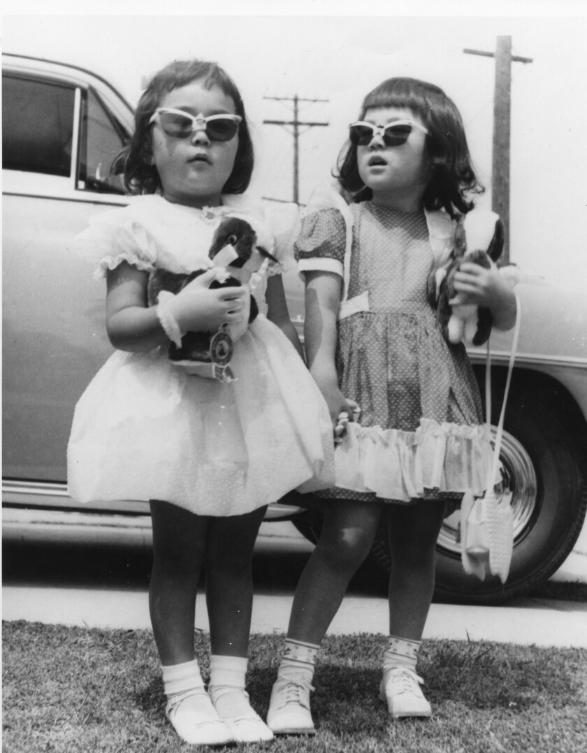 "A photograph of 6-year-olds Diane Funada, left, and her best friend Naomi Okamoto, dressed for Easter in L.A. in April 1956, featured in Carolyn Kozo Cole's project ""Shades of L.A."""