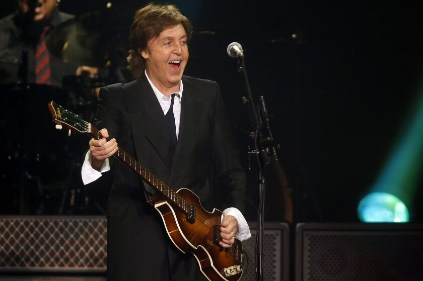 FILE - In this June 8, 2013 file photo, Paul McCartney performs during a concert at the Barclays Center in New York. Bob Dylan, Billy Joel and Willie Nelson are among the artists performing McCartney songs in a massive tribute to the former Beatle due out in November. (Photo by Jason DeCrow/Invision/AP, File)
