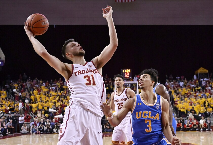 Basketball players Nick Rakocevic of USC and Jules Bernard of UCLA