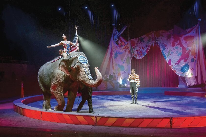 An elephant display opens a Ringling Bros. and Barnum & Bailey show last month in Tennessee. The circus' parent company announced Thursday that it will phase out the show's elephants by 2018.