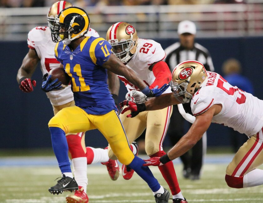 St. Louis Rams wide receiver Tavon Austin slips away from a tackle attempt by San Francisco 49ers linebacker Michael Wilhoite as he scores a touchdown during the second half of an NFL football game Sunday, Nov. 1, 2015, in St. Louis. (Chris Lee/St. Louis Post-Dispatch via AP)  EDWARDSVILLE INTELLIG