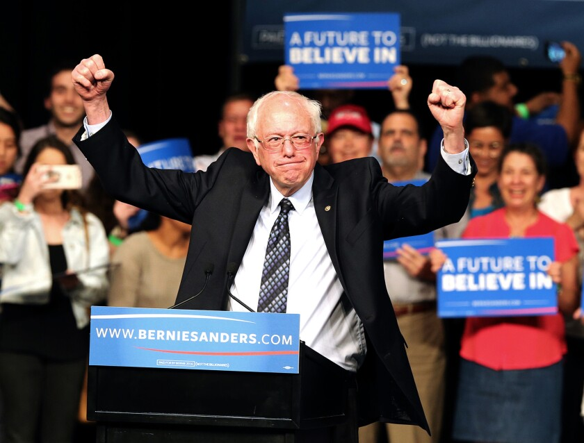 Democratic presidential candidate Bernie Sanders acknowledges his supporters during a campaign event Tuesday night in Miami.