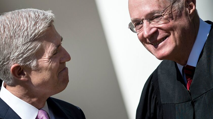 At his swearing-in ceremony last year, Neil Gorsuch, left, President Trump's appointee to the U.S. Supreme Court, smiles with Justice Anthony Kennedy, who recently announced he is retiring.