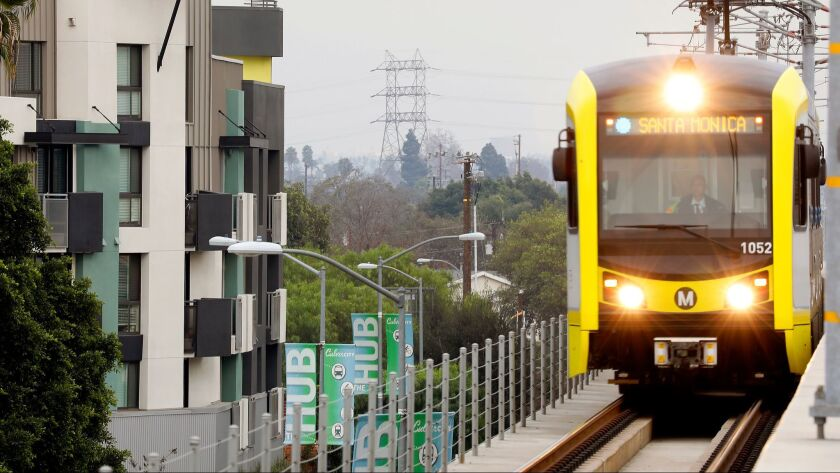 A Metro Expo Line train passes an apartment complex in Culver City.