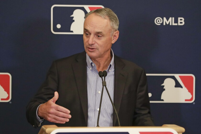MLB Commissioner Rob Manfred answers questions at a news conference.