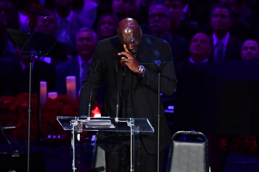 """Retired US basketball player Michael Jordan cries as he speaks during the """"Celebration of Life for Kobe and Gianna Bryant"""" service at Staples Center in Downtown Los Angeles on February 24, 2020. - Kobe Bryant, 41, and 13-year-old Gianna were among nine people killed in a helicopter crash in the rugged hills west of Los Angeles on January 26. (Photo by Frederic J. BROWN / AFP) (Photo by FREDERIC J. BROWN/AFP via Getty Images)"""