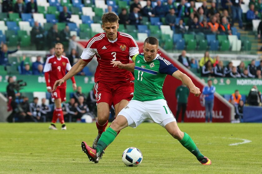 Northern Ireland's Conor Washington, right, and Belarus' Aleksandr Martynovich during the international friendly soccer match Northern Ireland against Belarus at Windsor Park, Belfast, Northern Ireland, Friday May 27, 2016. (Niall Carson  / PA via AP) UNITED KINGDOM OUT - NO SALES - NO ARCHIVES