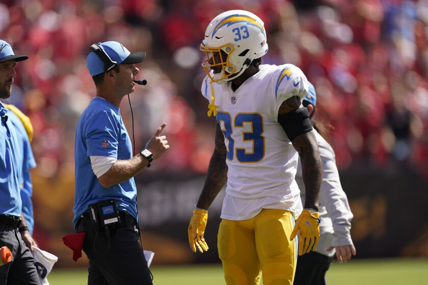 Chargers head coach Brandon Staley talks with Derwin James during their game against the Chiefs.