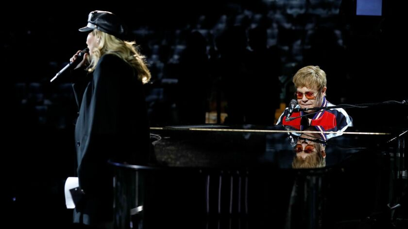 Elton John rehearses with Miley Cyrus for the 60th Grammy Awards show at Madison Square Garden in New York on Jan. 25.