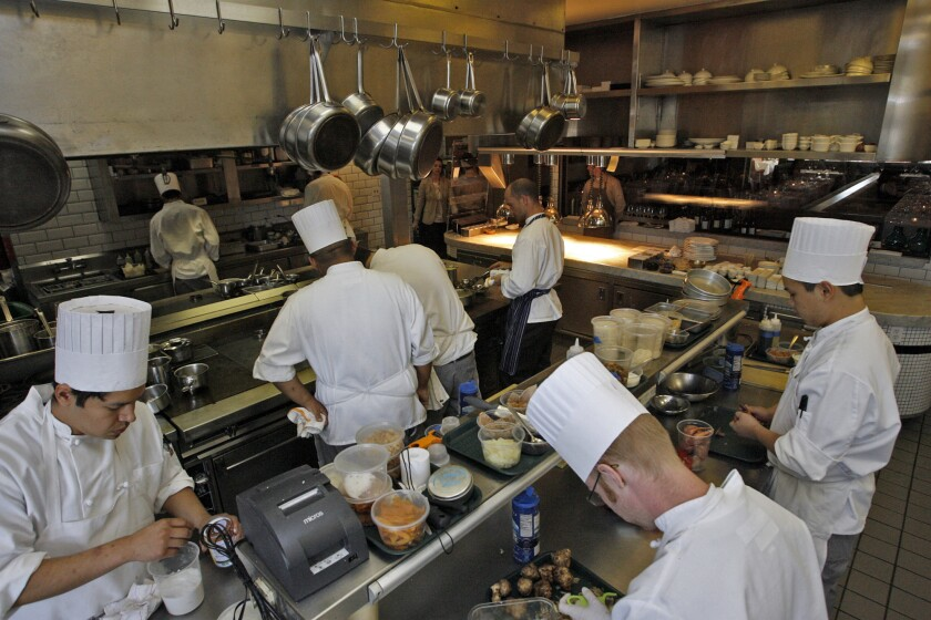 Staffers work in the spacious kitchen at Hatfield's in Los Angeles in 2010. The fine dining restaurant is closing after eight years.