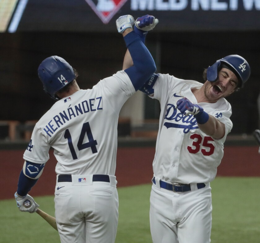 Dodgers' Cody Bellinger, right, celebrates with teammate Kiké Hernandez after hitting a home run