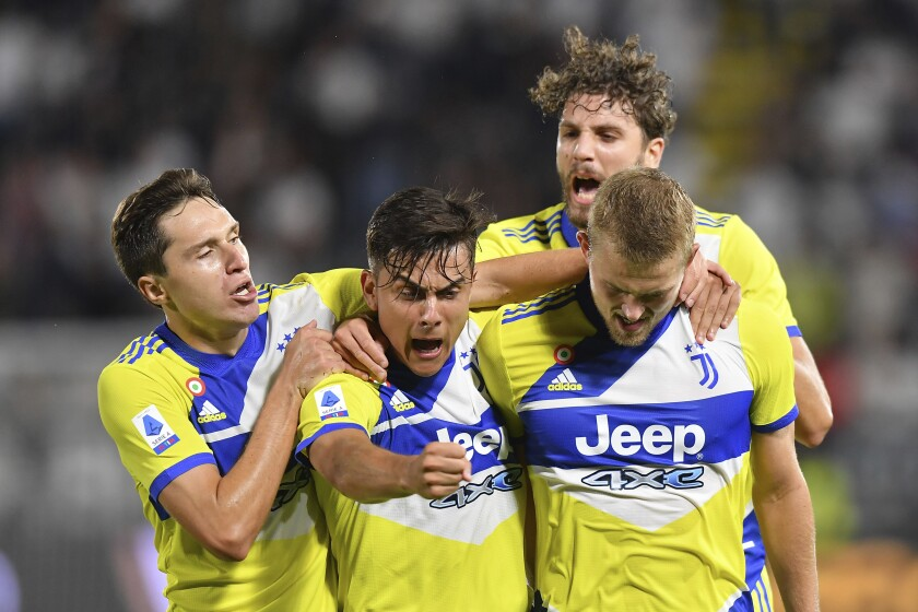 Juventus' Matthijs de Ligt, right, celebrates with teammates, from left, Federico Chiesa, Paulo Dybala and Manuel Locatelli, after scoring during the Italian Serie A soccer match between Spezia and Juventus, at the Alberto Picco stadium in La Spezia, Italy, Wednesday, Sept. 22, 2021. (Tano Pecoraro/LaPresse via AP)