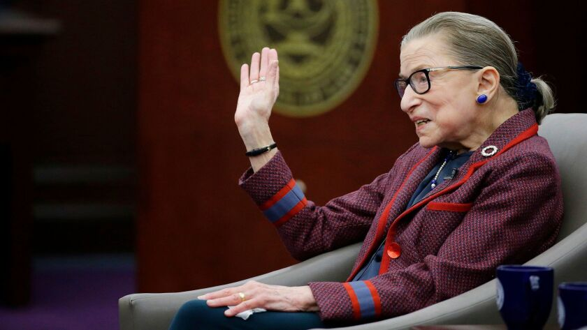 "Supreme Court Justice Ruth Bader Ginsburg waves goodbye to those who came to listen and participate in her ""fireside chat"" in Bristol, R.I. on Jan. 30."