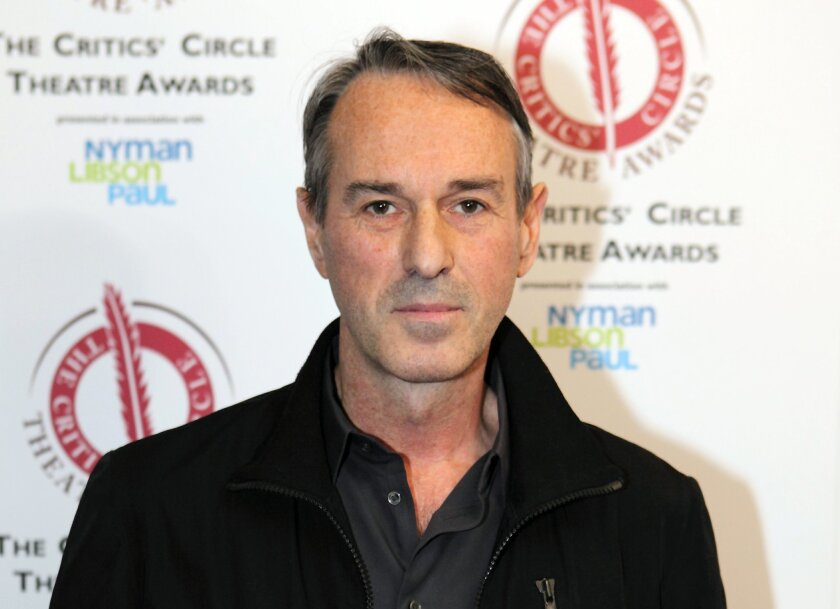 """FILE - In this Jan. 27, 2015 file photo, director Ivo Van Hove poses for photographers after winning the best director award for the play """"A View From the Bridge""""  at the Critics' Circle Theatre Awards in central London. Van Hove has two Broadway revivals of Arthur Miller plays _ """"A View From the B"""