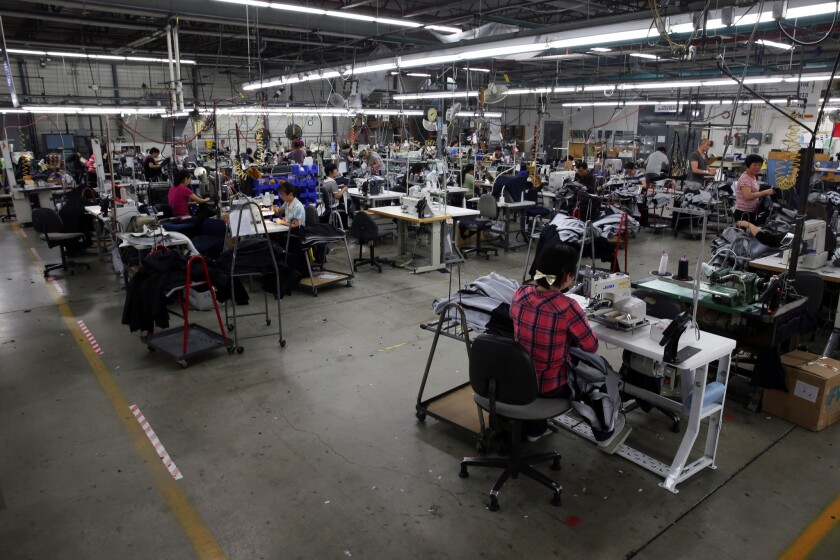 Employees work Feb. 22, 2017, at the Hart Schaffner Marx suit-making factory in Des Plaines.