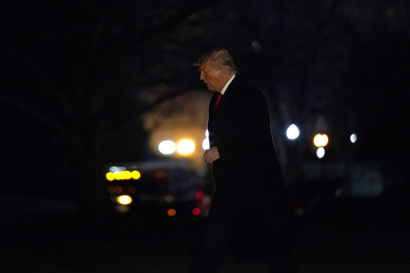 President Donald Trump arrives on the South Lawn of the White House, Tuesday, Jan. 12, 2021, in Washington.