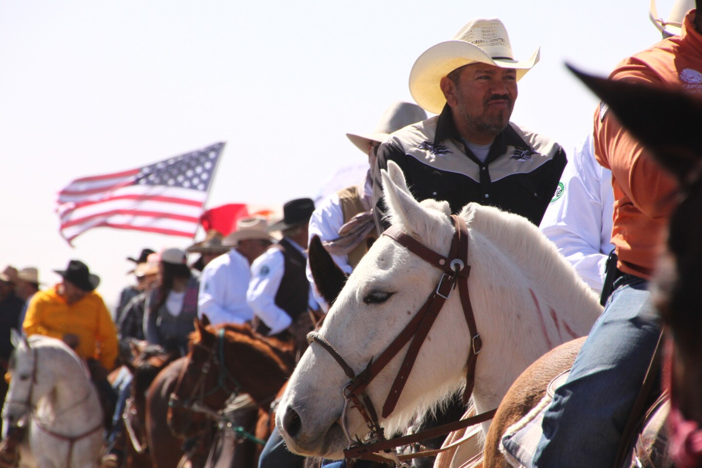 In the Cabalgata Binacional, riders from Mexico and the U.S. gather at the border and ride three miles together into Columbus, N.M.