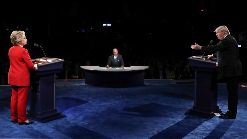 Republican presidential nominee Donald Trump gestures toward Democratic presidential nominee Hillary Clinton during the presidential debate at Hofstra University in Hempstead, N.Y., on Sept. 26.