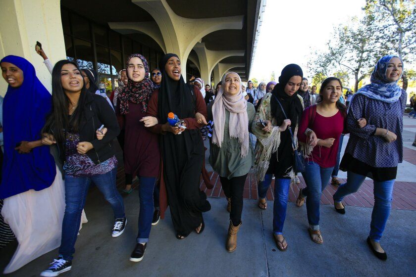 Students lead a march at SDSU on Monday in response to a hate crime against a female Muslim student in a campus parking lot last week. About 400 people participated in the march and rally against intolerance.