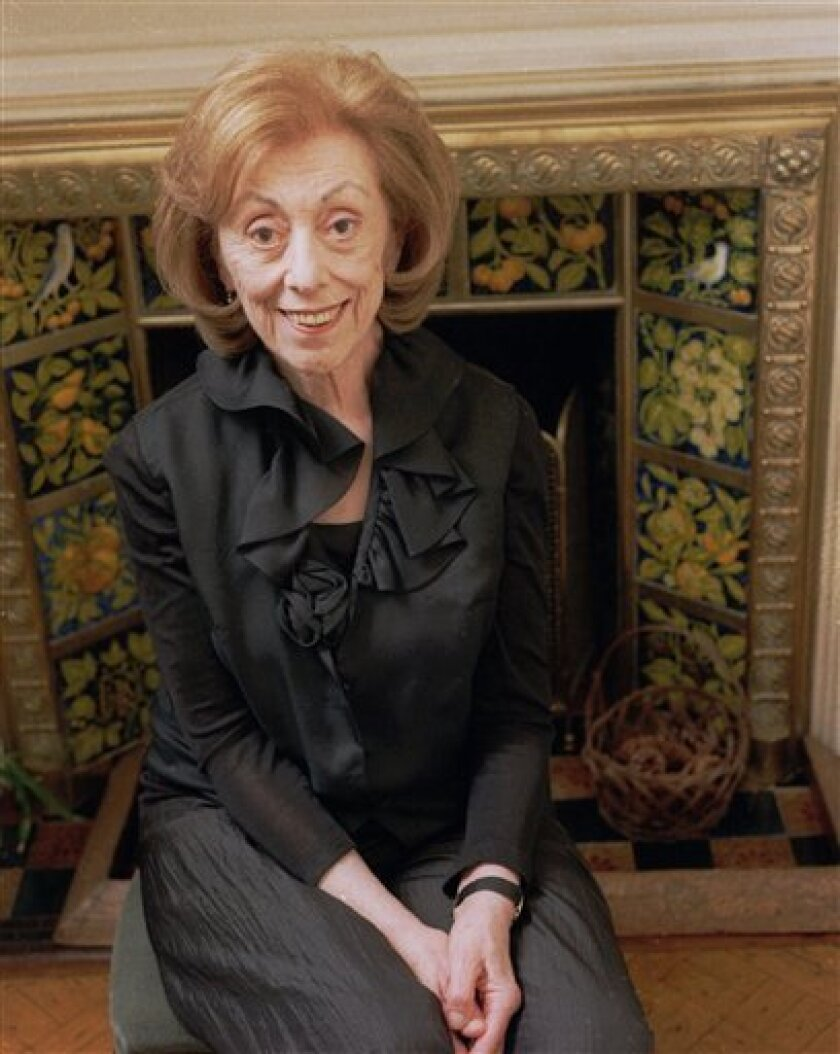 """In this Nov. 26, 1997 file photo, author Hortense Calisher poses for a portrait at her apartment in New York. Calisher, a prize-winning writer and former president of PEN known for her dense, unskimmable prose in such works of fiction as """"False Entry"""" and """"In Greenwich There Are Many Gravelled Wal"""