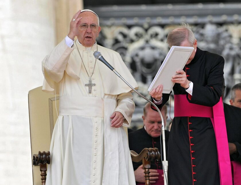 Pope Francis blesses the faithful during his weekly general audience in Vatican City on May 11, 2016.
