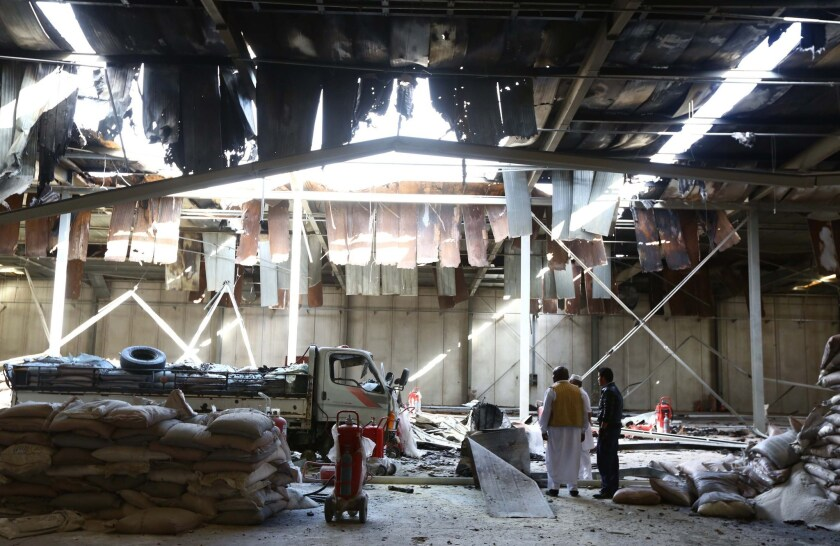 A warehouse was damaged in an airstrike carried out by pro-government forces in the Libyan city of Zuara on Dec. 3. U.S. officials have tried not to get involved with the chaos in Libya.