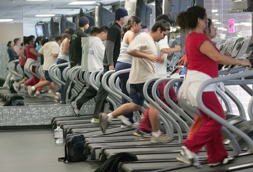 People on treadmills at a gym