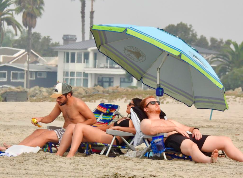 Smoke from the wildfires continued to mute the sun on Sunday at Coronado