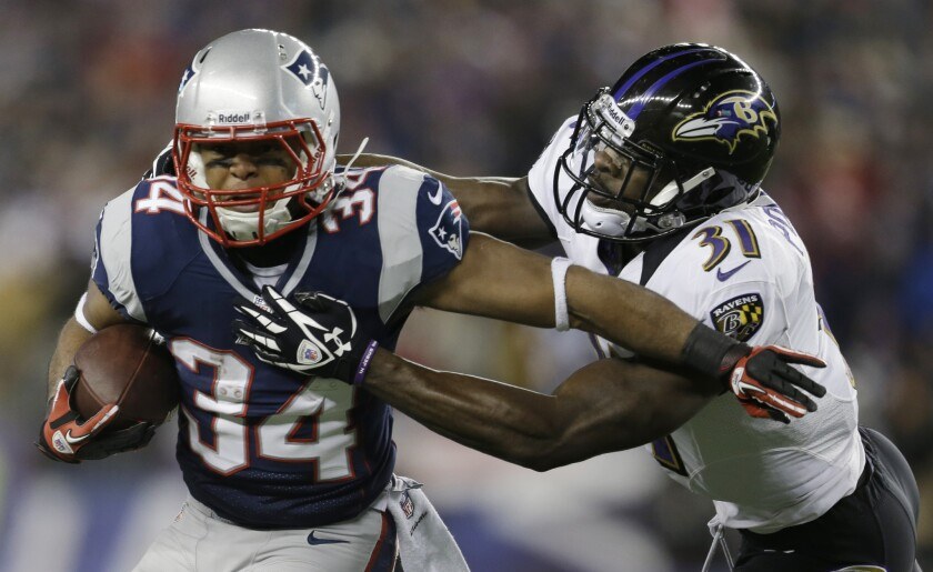 New England Patriots running back Shane Vereen, left, is tackled by Baltimore Ravens safety Bernard Pollard in the AFC championship game.