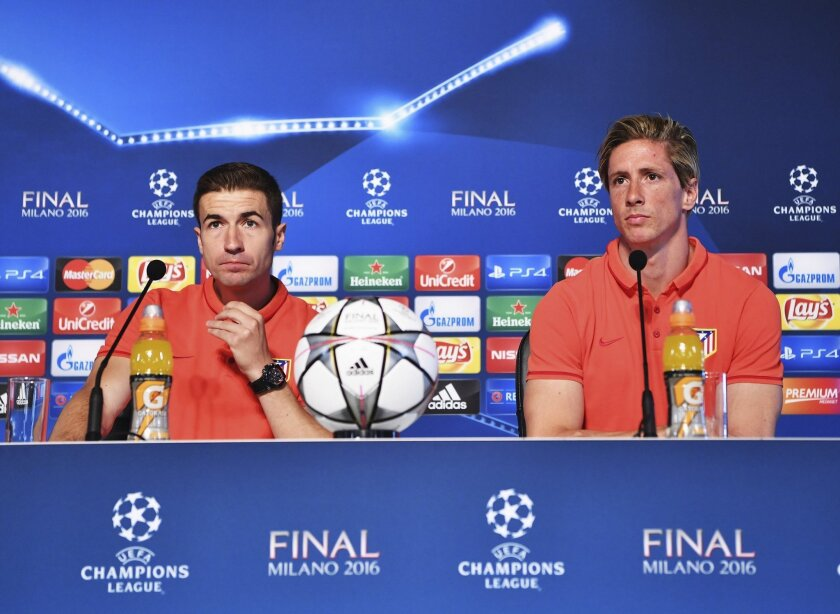 In this photo provided by UEFA Atletico Madrid players Fernando Torres, right, and Gabi attend a press conference at the San Siro stadium in Milan, Italy, Friday, May 27, 2016. The Champions League final soccer match between Real Madrid and Atletico Madrid will be held at the San Siro stadium on Sa