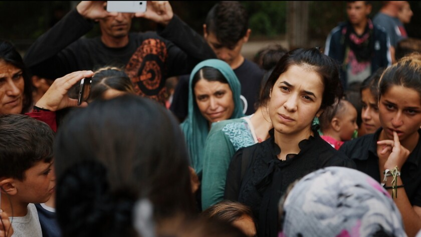 """Nadia Murad, in black at center-right, in the documentary """"On Her Shoulders."""""""