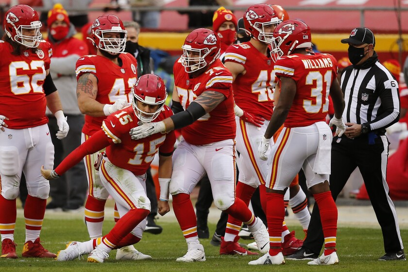 Quarterback Patrick Mahomes (15) of the Kansas City Chiefs needed assistance from offensive tackle Mike Remmers (75).