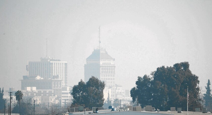 A heavy haze envelops the downtown Fresno skyline in January 2014.