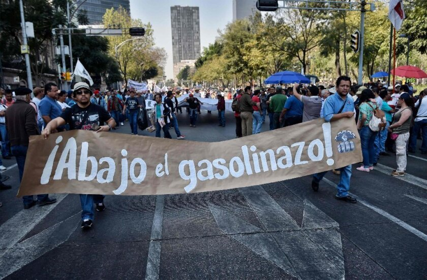 Members of the Mexican Union of Electricians and others protest against the fuel price hikes in Mexico City on Jan. 26.