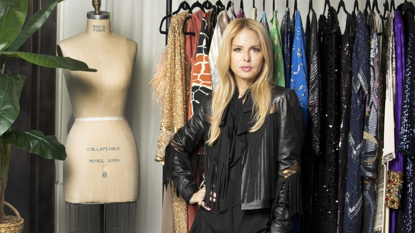 Designer Rachel Zoe stands in front of a rack of prized vintage pieces she's planning to part with. She's selling those goods as well as pieces from her collection at her new store at the Palisades Village shopping center in Pacific Palisades.