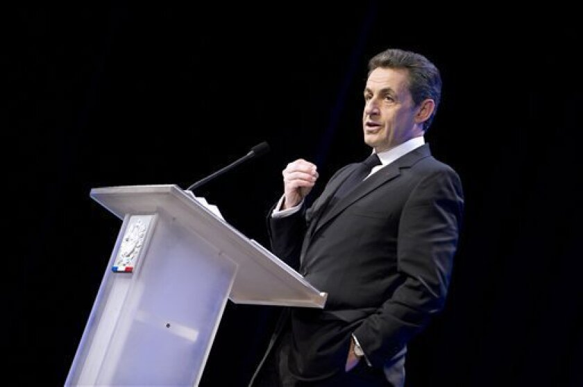 French President Nicolas Sarkozy delivers his speech during a visit in Longjumeau, south of Paris, dedicated to housing policy, Thursday Feb. 2, 2012.(AP Photo/Lionel Bonaventure/Pool)
