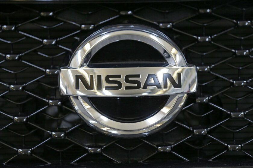 FILE - This Feb. 14, 2013 file photo shows the Nissan logo on the grill of a 2013 Nissan Pathfinder on display at the 2013 Pittsburgh Auto Show in Pittsburgh. Nissan is recalling nearly 80,000 Pathfinder SUVs in the U.S. because the brake lights can stay on even when the driver isn't stopping. The