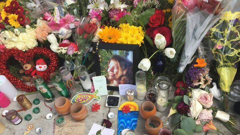 A makeshift memorial for a student killed in an accident near Mission Hills High School Saturday included a photo of the student with notes, balloons, prayer votives, a rosary and about 100 bouquets.