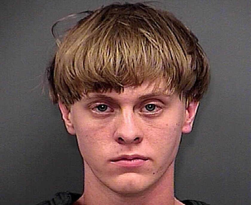 FILE - This Thursday, June 18, 2015, file photo, provided by the Charleston County Sheriff's Office shows Dylann Roof. A federal magistrate in Charleston, S.C., entered not guilty pleas on 33 federal charges, Friday, July 31, 2015, including for hate crimes, for Roof, a white man accused of gunning down nine parishioners at a black church in Charleston. (Charleston County Sheriff's Office via AP)