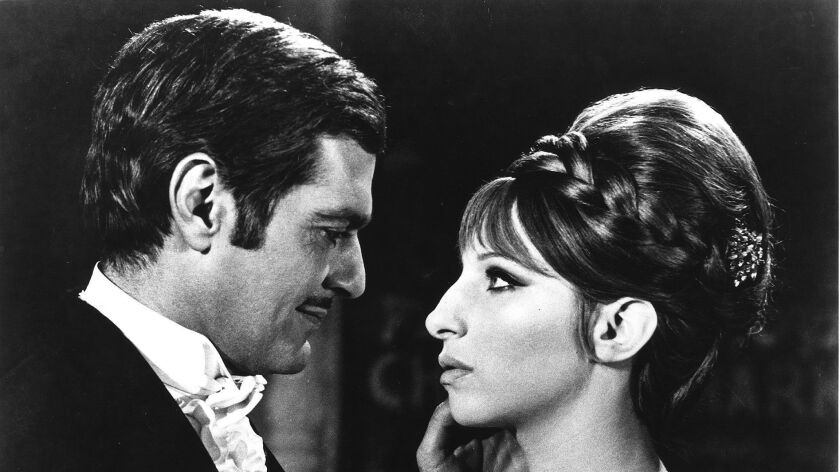 "Barbra Streisand, here with Omar Sharif, made her film debut in 1968 in the film ""Funny Girl."""