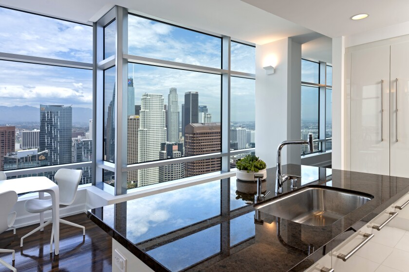 """Jason Blum, who produced the films """"The Purge"""" and """"Get Out,"""" is asking $6.995 million for his corner penthouse at the Ritz-Carlton Residences at L.A. Live. The 4,250-square-foot unit features a wealth of open-concept space, multiple dining areas and a private terrace. Walls of floor-to-ceiling windows take in sweeping views of the downtown skyline and the L.A. Live pavilion below."""