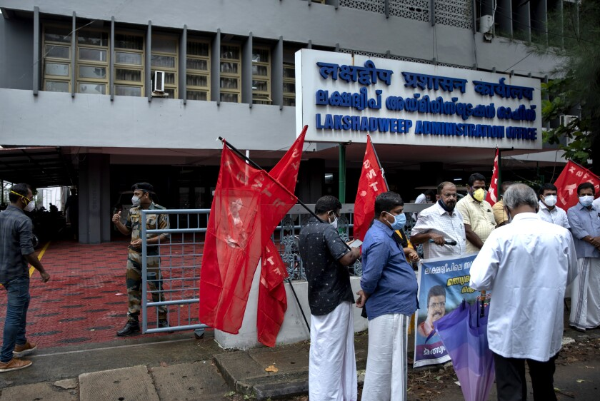 Activists carry red flags