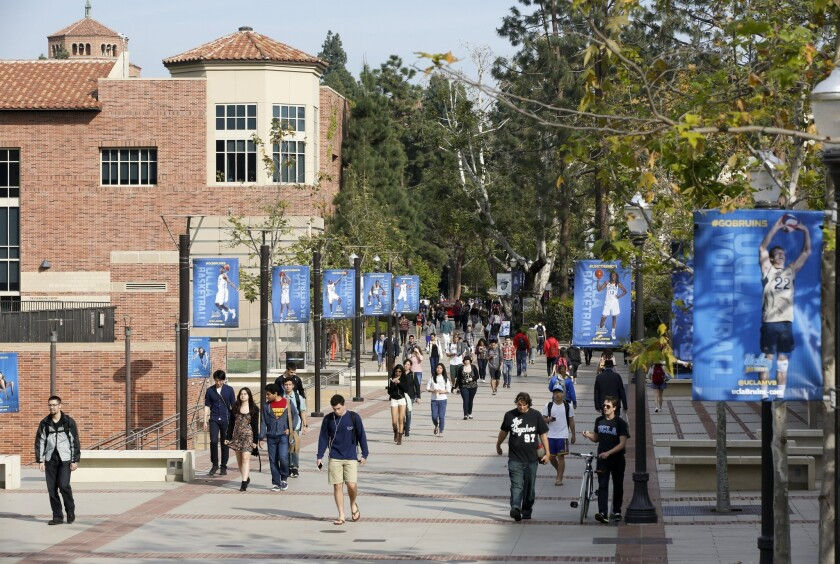 FILE - In this Feb. 26, 2015 file photo, students walk on the UCLA campus in Los Angeles. Fewer Cali
