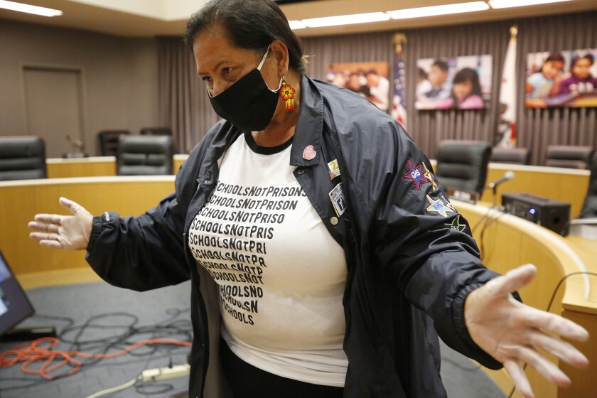 Los Angeles School Board member Monica Garcia wears a mask during a school board meeting.