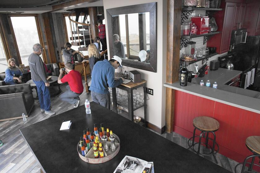 Visitors view the living and dining area near the kitchen during a free tour Saturday of the Sunset Beach water tower house, which actually is in Seal Beach.