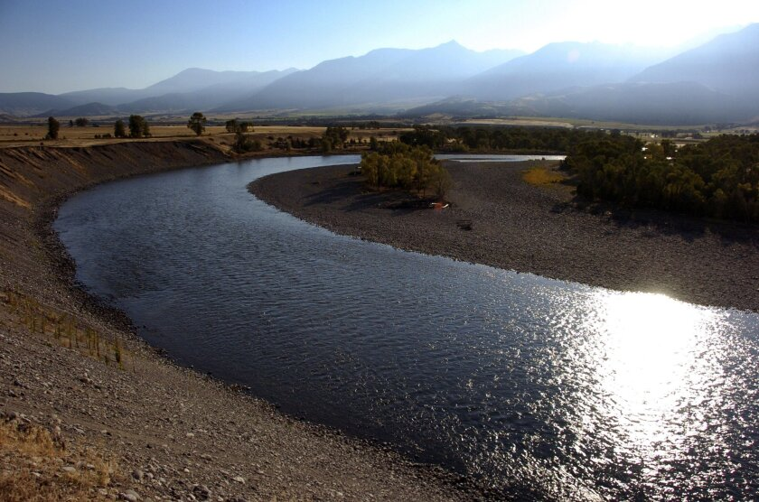 FILE--This Aug. 21, 2016, file photo shows the Yellowstone River near Pray, Mont. Montana re-opened portions of the Yellowstone River Thursday, Sept. 1, but is keeping a popular stretch closed due to a fish-killing parasite. (AP Photo/Matthew Brown, file)