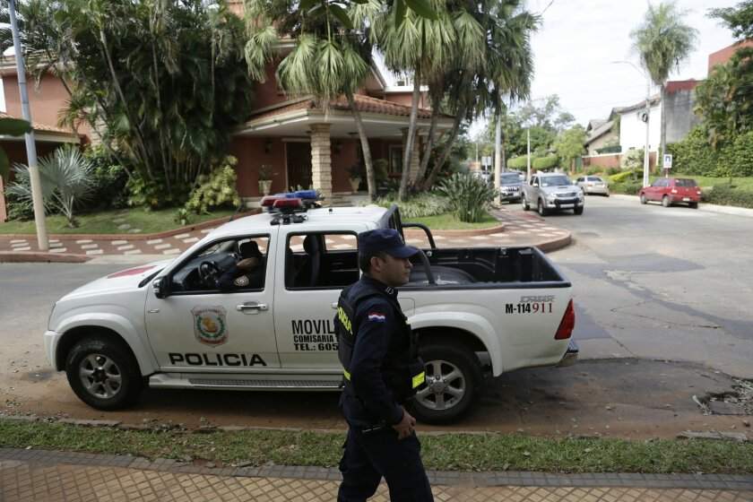 Police patrol outside the home of Nicolas Leoz who's under house arrest in Asuncion, Paraguay, Wednesday, June 3, 2015. Leoz, former Conmebol president and former FIFA executive member, was indicted in a bribery and money-laundering scheme in a FIFA investigation. Leoz has said he'll fight a U.S. e