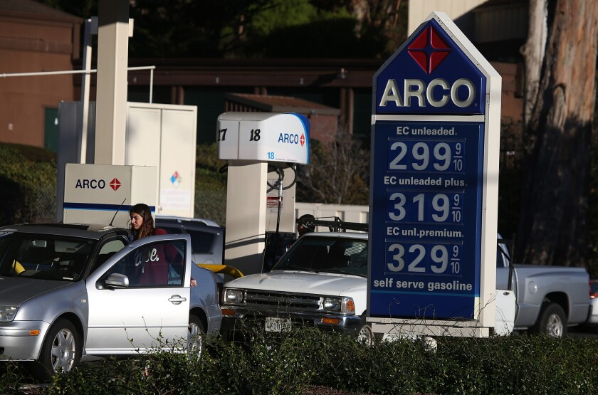 Gas prices are displayed at an Arco gas station on October 27 in Mill Valley. Gas prices have fallen to their lowest level in four years with the national average for a gallon of regular gasoline dropping to $3.08.
