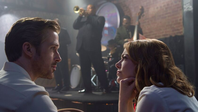 "Ryan Gosling, left, and Emma Stone in a scene from ""La La Land."""